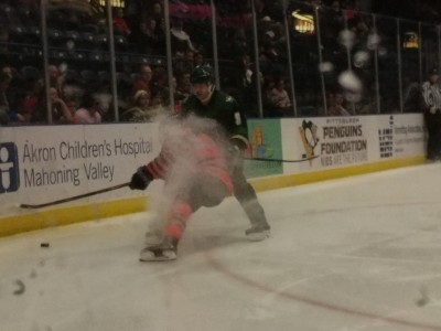 An unnamed Phantom fights for the puck against the Sioux City Musketeers.