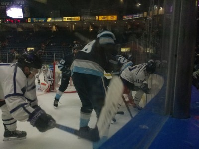 The Phantoms try to dig the puck out from along the boards against the Madison Capitols.