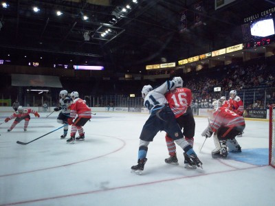 Trevor Kuntar boxes out a Capitols player as the Phantoms lose their home opener in a heartbreaking OT loss to Madison.